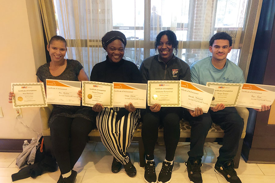 Group photo of graduates with certificates of 2018 Fall Cook Apprenticeship Training