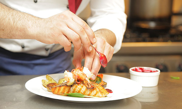 Chef plating a dish